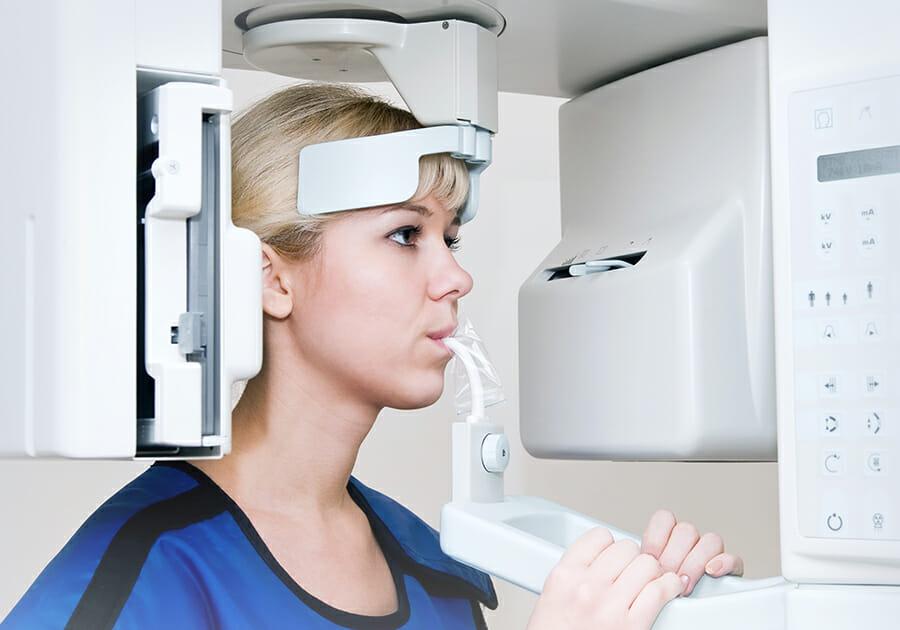 Dentist showing patient dental patient education software