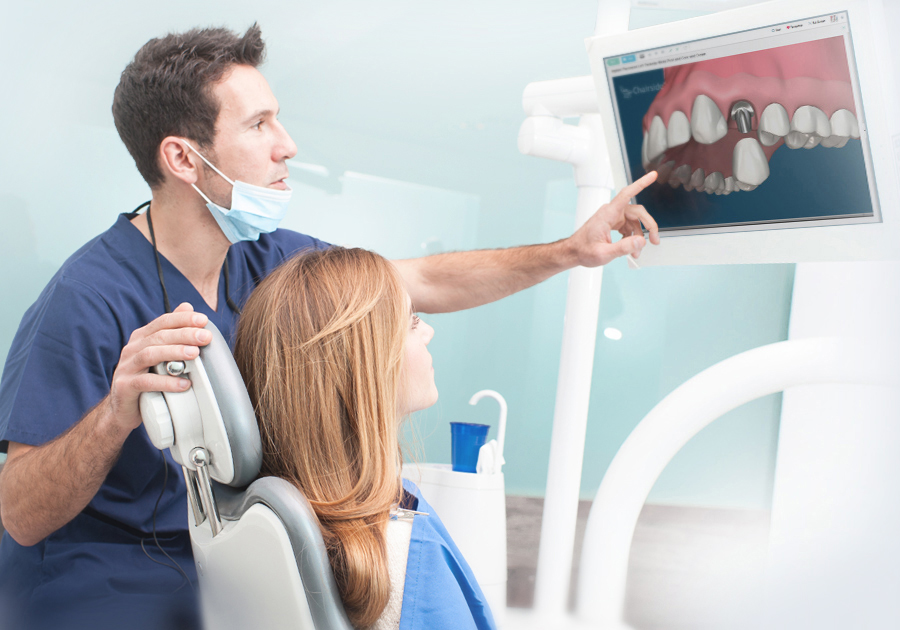 Dentist showing patient dental patient education software